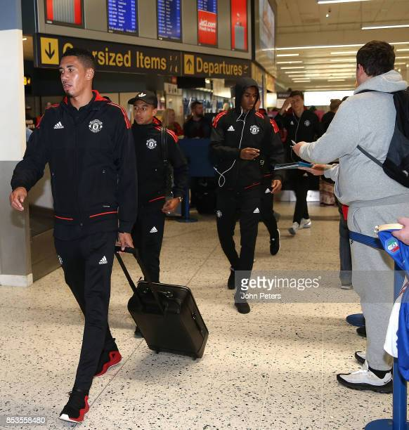 Chris Smalling Jesse Lingard and Marcus Rashford of Manchester United check in ahead of the flight to Moscow for their Champions League fixture...