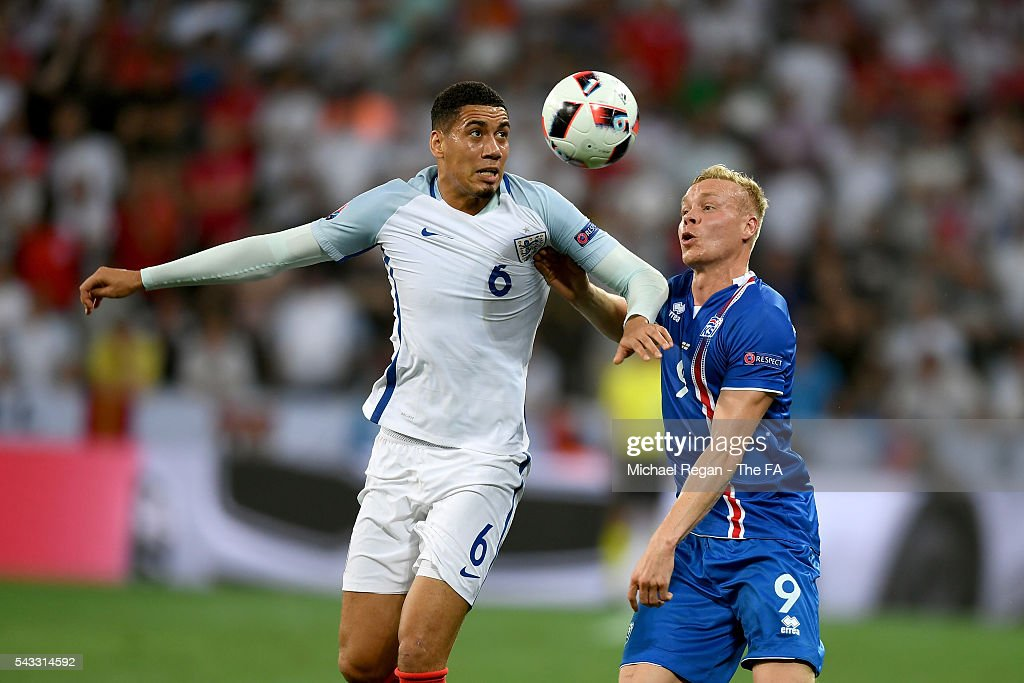 <a gi-track='captionPersonalityLinkClicked' href=/galleries/search?phrase=Chris+Smalling&family=editorial&specificpeople=5964313 ng-click='$event.stopPropagation()'>Chris Smalling</a> of England and <a gi-track='captionPersonalityLinkClicked' href=/galleries/search?phrase=Kolbeinn+Sigthorsson&family=editorial&specificpeople=4649188 ng-click='$event.stopPropagation()'>Kolbeinn Sigthorsson</a> of Iceland compete for the ball during the UEFA EURO 2016 round of 16 match between England and Iceland at Allianz Riviera Stadium on June 27, 2016 in Nice, France.