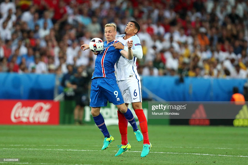Chris Smalling of England and Kolbeinn Sigthorsson of Iceland during the European Championship match Round of 16 between England and Iceland at Allianz Riviera Stadium on June 27, 2016 in Nice, France.