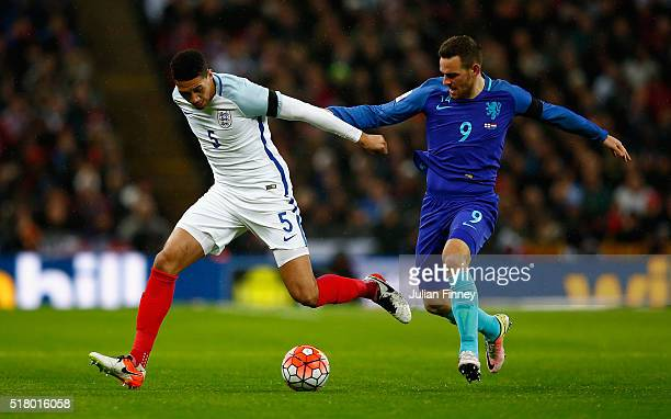 Chris Smalling of England and Vincent Janssen of the Netherlands battle for the ball during the International Friendly match between England and...
