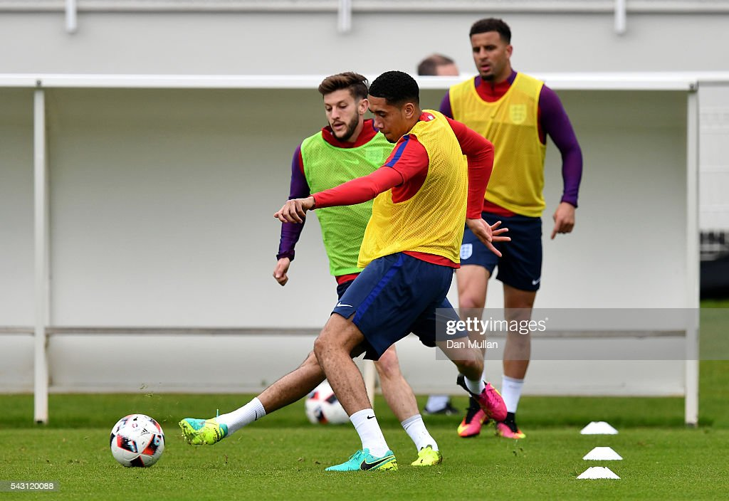 <a gi-track='captionPersonalityLinkClicked' href=/galleries/search?phrase=Chris+Smalling&family=editorial&specificpeople=5964313 ng-click='$event.stopPropagation()'>Chris Smalling</a> of England holds off <a gi-track='captionPersonalityLinkClicked' href=/galleries/search?phrase=Adam+Lallana&family=editorial&specificpeople=5475862 ng-click='$event.stopPropagation()'>Adam Lallana</a> of England during a training session ahead of the UEFA Euro 2016 match against Iceland at Stade du Bourgognes on June 26, 2016 in Chantilly, France.
