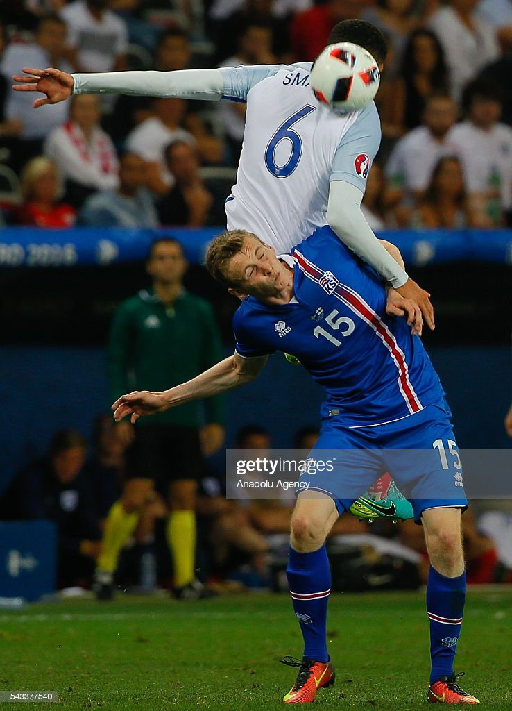 Chris Smalling (6) of England in action against Jon Dadi Bödvarsson (15) of Iceland during the UEFA Euro 2016 Round of 16 football match between Iceland and England at Stade de Nice in Nice, France on June 27, 2016.