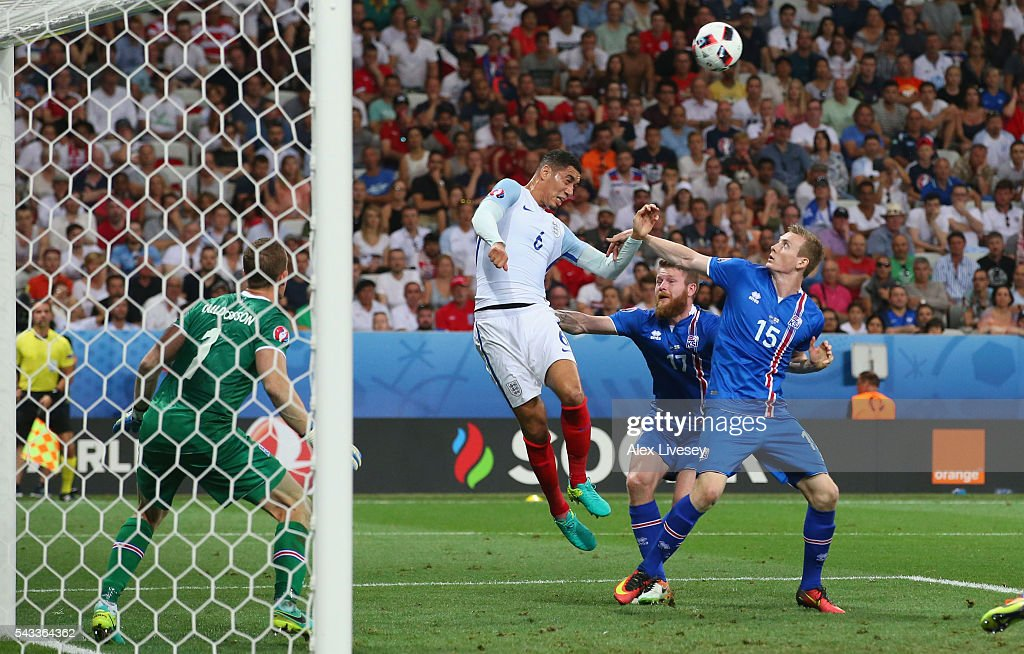 <a gi-track='captionPersonalityLinkClicked' href=/galleries/search?phrase=Chris+Smalling&family=editorial&specificpeople=5964313 ng-click='$event.stopPropagation()'>Chris Smalling</a> of England jumps for the ball during the UEFA EURO 2016 round of 16 match between England and Iceland at Allianz Riviera Stadium on June 27, 2016 in Nice, France.