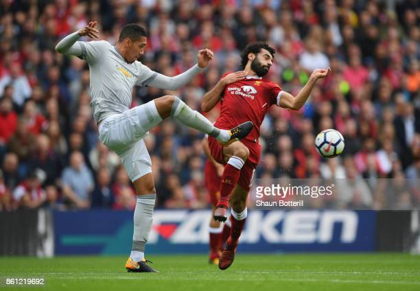 Chris Smalling of Manchester United and Mohamed Salah of Liverpool battle for possession during the Premier League match between Liverpool and...