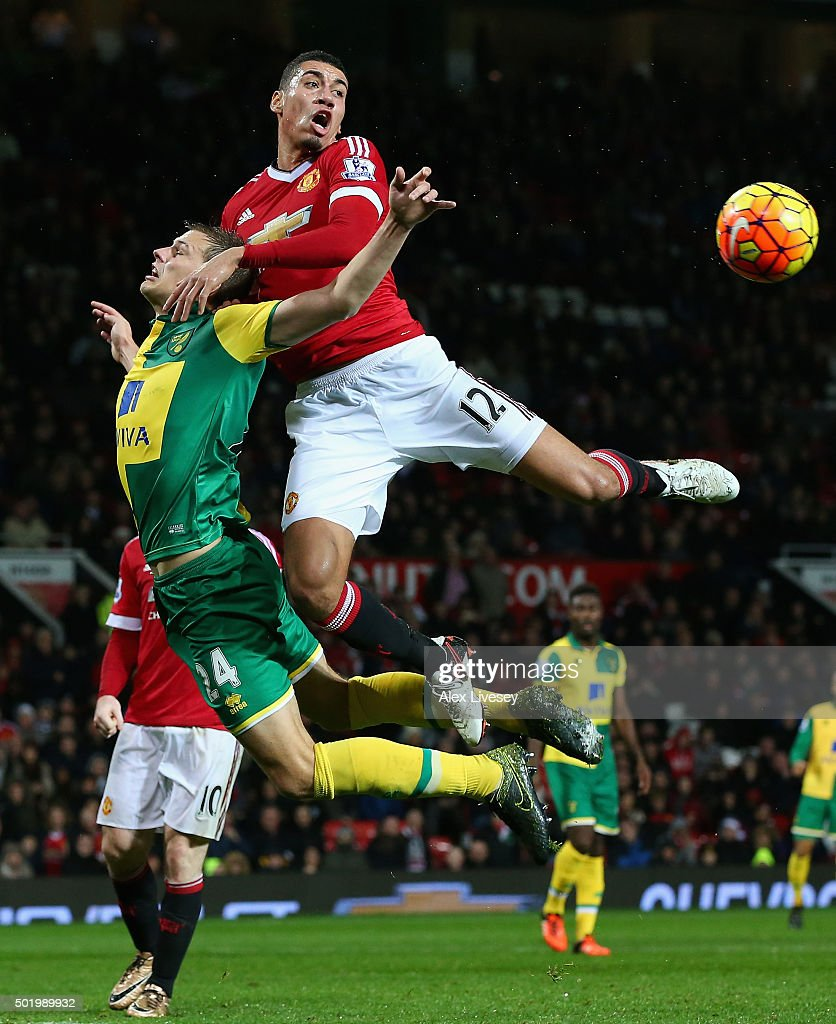 Chris Smalling of Manchester United and Ryan Bennett of Norwich City compete for the ball during the Barclays Premier League match between Manchester United and Norwich City at Old Trafford on December 19, 2015 in Manchester, England.