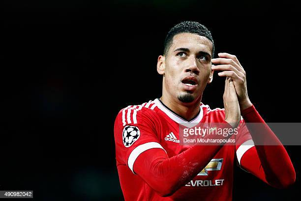 Chris Smalling of Manchester United applauds the crowd after victory in the UEFA Champions League Group B match between Manchester United FC and VfL...