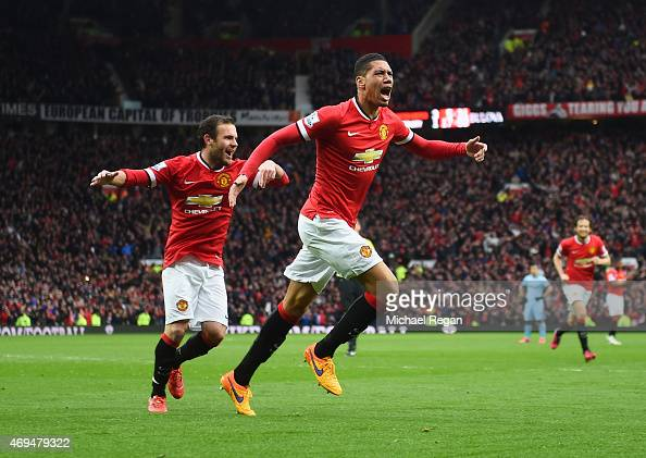 Chris Smalling of Manchester United celebrates as he scores their fourth goal during the Barclays Premier League match between Manchester United and...