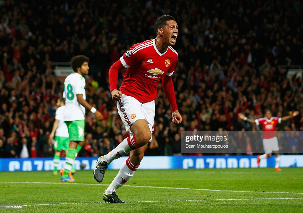 <a gi-track='captionPersonalityLinkClicked' href=/galleries/search?phrase=Chris+Smalling&family=editorial&specificpeople=5964313 ng-click='$event.stopPropagation()'>Chris Smalling</a> of Manchester United celebrates as he scores their second goal during the UEFA Champions League Group B match between Manchester United FC and VfL Wolfsburg at Old Trafford on September 30, 2015 in Manchester, United Kingdom.