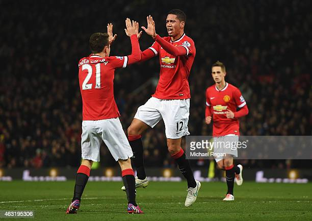 Chris Smalling of Manchester United celebrates scoring his second goal during the Barclays Premier League match between Manchester United and Burnley...