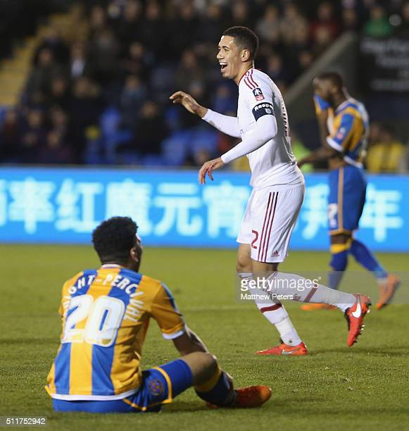 Chris Smalling of Manchester United celebrates scoring their first goal during the Emirates FA Cup Fifth Round match between Shrewsbury Town and...