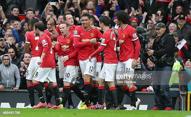Chris Smalling of Manchester United celebrates scoring their fourth goal during the Barclays Premier League match between Manchester United and...