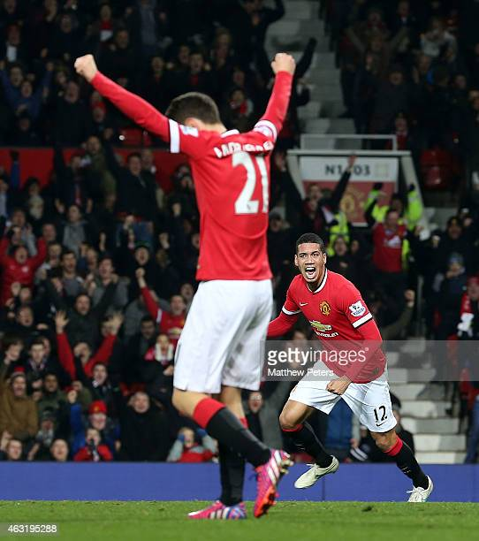 Chris Smalling of Manchester United celebrates scoring their second goal during the Barclays Premier League match between Manchester United and...