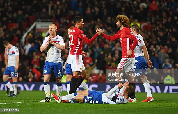 Chris Smalling of Manchester United celebrates with Marouane Fellaini of Manchester United as he scores their second goal during the Emirates FA Cup...