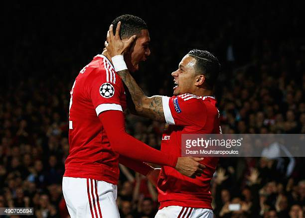 Chris Smalling of Manchester United celebrates with team mate Memphis Depay as he scores their second goal during the UEFA Champions League Group B...