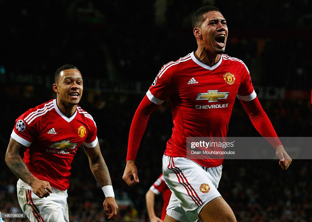 <a gi-track='captionPersonalityLinkClicked' href=/galleries/search?phrase=Chris+Smalling&family=editorial&specificpeople=5964313 ng-click='$event.stopPropagation()'>Chris Smalling</a> of Manchester United (R) celebrates with team mate <a gi-track='captionPersonalityLinkClicked' href=/galleries/search?phrase=Memphis+Depay&family=editorial&specificpeople=7189987 ng-click='$event.stopPropagation()'>Memphis Depay</a> as he scores their second goal during the UEFA Champions League Group B match between Manchester United FC and VfL Wolfsburg at Old Trafford on September 30, 2015 in Manchester, United Kingdom.