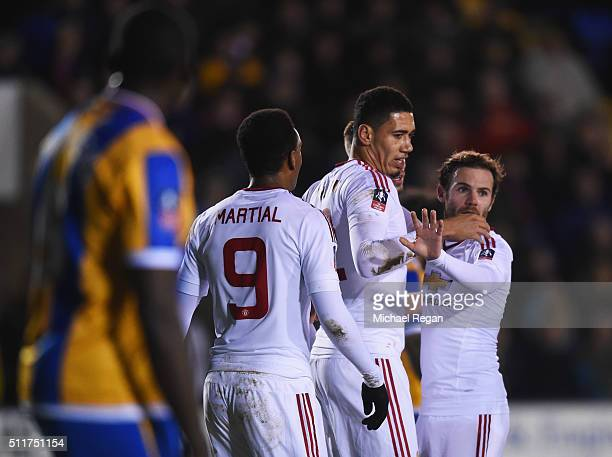 Chris Smalling of Manchester United celebrates with team mates as he scores their first goal during the Emirates FA Cup fifth round match between...