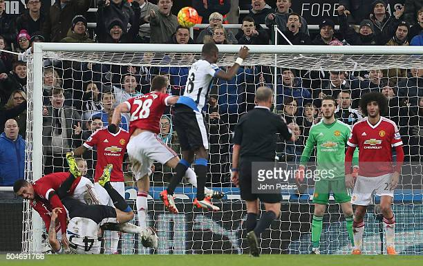 Chris Smalling of Manchester United fouls Aleksandar Mitrovic of Newcastle United to concede a penalty during the Barclays Premier League match...