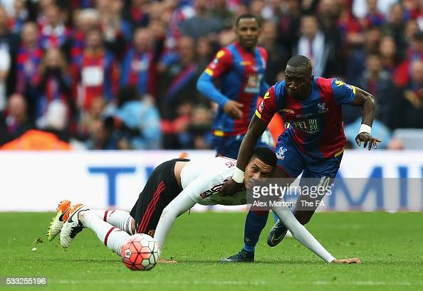 Chris Smalling of Manchester United fouls Yannick Bolasie of Crystal Palace resulting in the second yellow card and sent off during The Emirates FA...