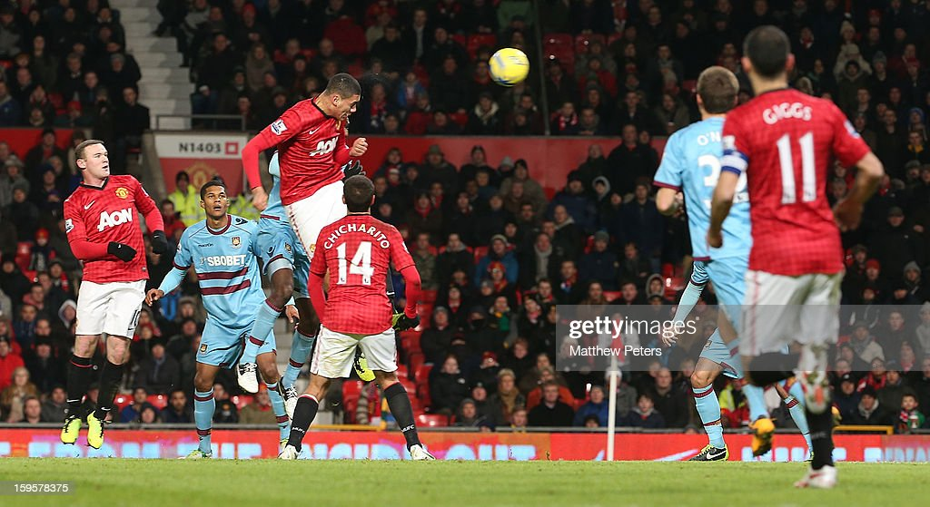 Chris Smalling of Manchester United has a header on goal during the FA Cup Third Round Replay between Manchester United and West Ham United at Old Trafford on January 16, 2013 in Manchester, England.