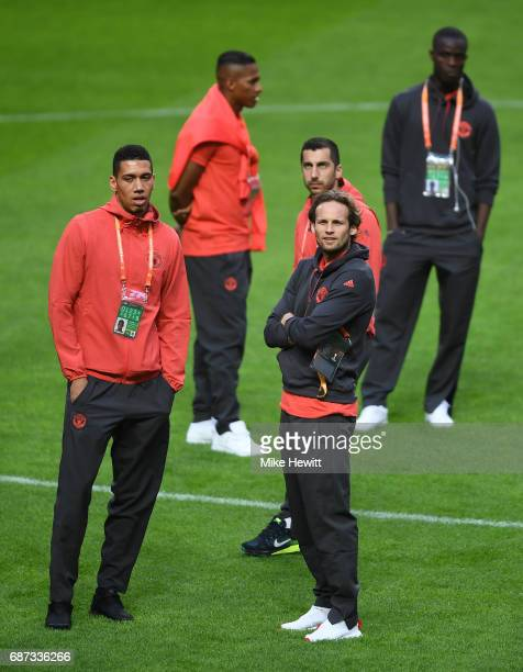 Chris Smalling of Manchester United Henrikh Mkhitaryan of Manchester United and Daley Blind of Manchester United take a look at the pitch during a...