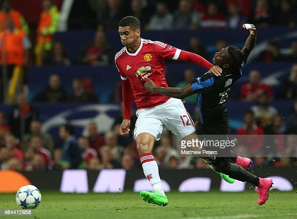 Chris Smalling of Manchester United in action with Abdoulay Diaby of Club Brugge during the UEFA Champions League playoff first leg match between...