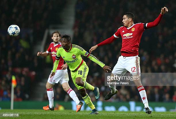 Chris Smalling of Manchester United in action with Ahmed Musa of CSKA Moscow during the UEFA Champions League match between Manchester United and...