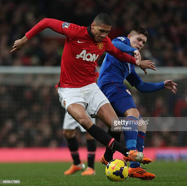 Chris Smalling of Manchester United in action with Declan John of Cardiff City during the Barclays Premier League match between Manchester United and...