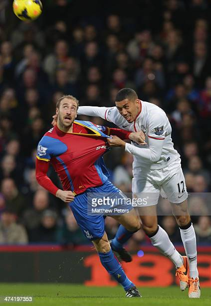 Chris Smalling of Manchester United in action with Glenn Murray of Crystal Palace during the Barclays Premier League match between Crystal Palace and...