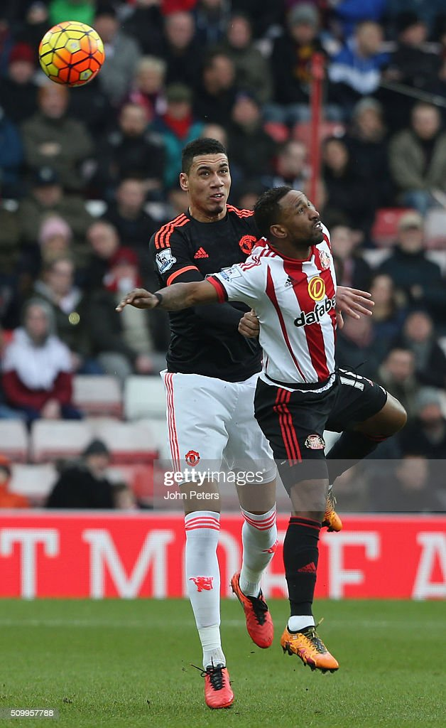 <a gi-track='captionPersonalityLinkClicked' href=/galleries/search?phrase=Chris+Smalling&family=editorial&specificpeople=5964313 ng-click='$event.stopPropagation()'>Chris Smalling</a> of Manchester United in action with <a gi-track='captionPersonalityLinkClicked' href=/galleries/search?phrase=Jermain+Defoe&family=editorial&specificpeople=171106 ng-click='$event.stopPropagation()'>Jermain Defoe</a> of Sunderland during the Barclays Premier League match between Sunderland and Manchester United at Stadium of Light on February 13, 2016 in Sunderland, England.