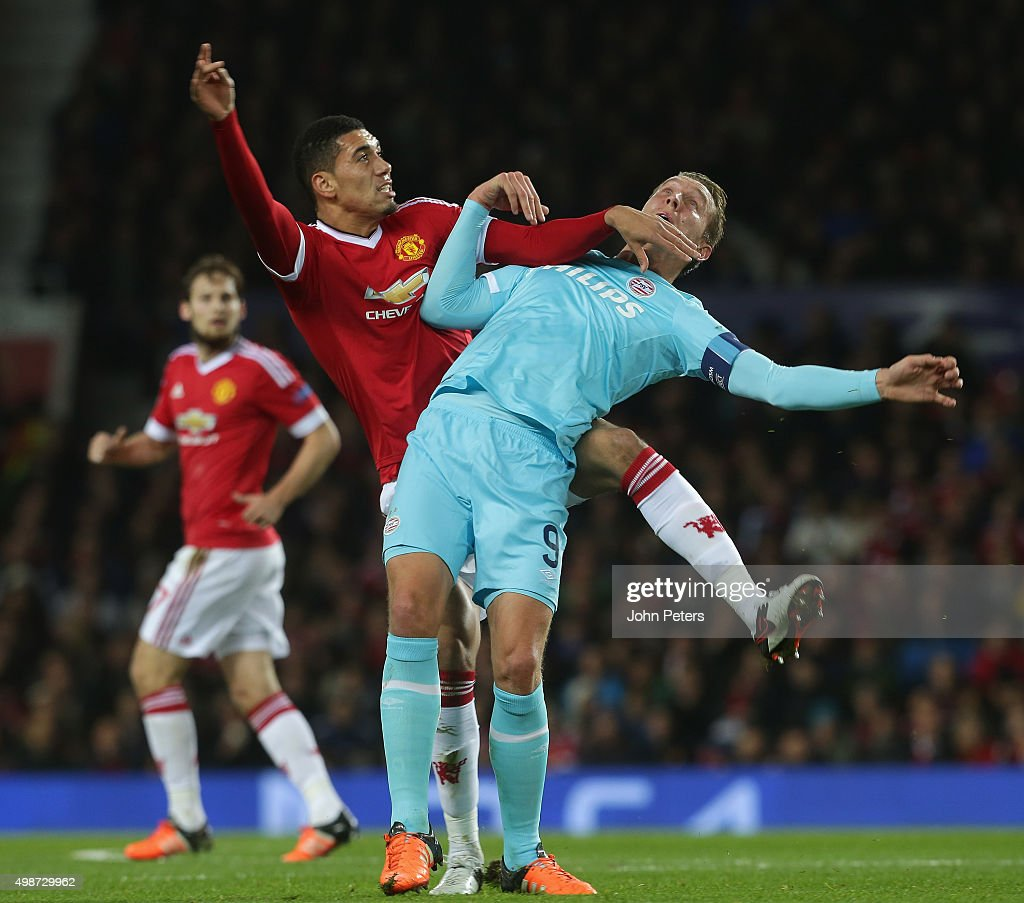 <a gi-track='captionPersonalityLinkClicked' href=/galleries/search?phrase=Chris+Smalling&family=editorial&specificpeople=5964313 ng-click='$event.stopPropagation()'>Chris Smalling</a> of Manchester United in action with Luuk de Jong of PSV Eindhoven during the UEFA Champions League match between Manchester United and PSV Eindhoven at Old Trafford on November 25, 2015 in Manchester, United Kingdom.