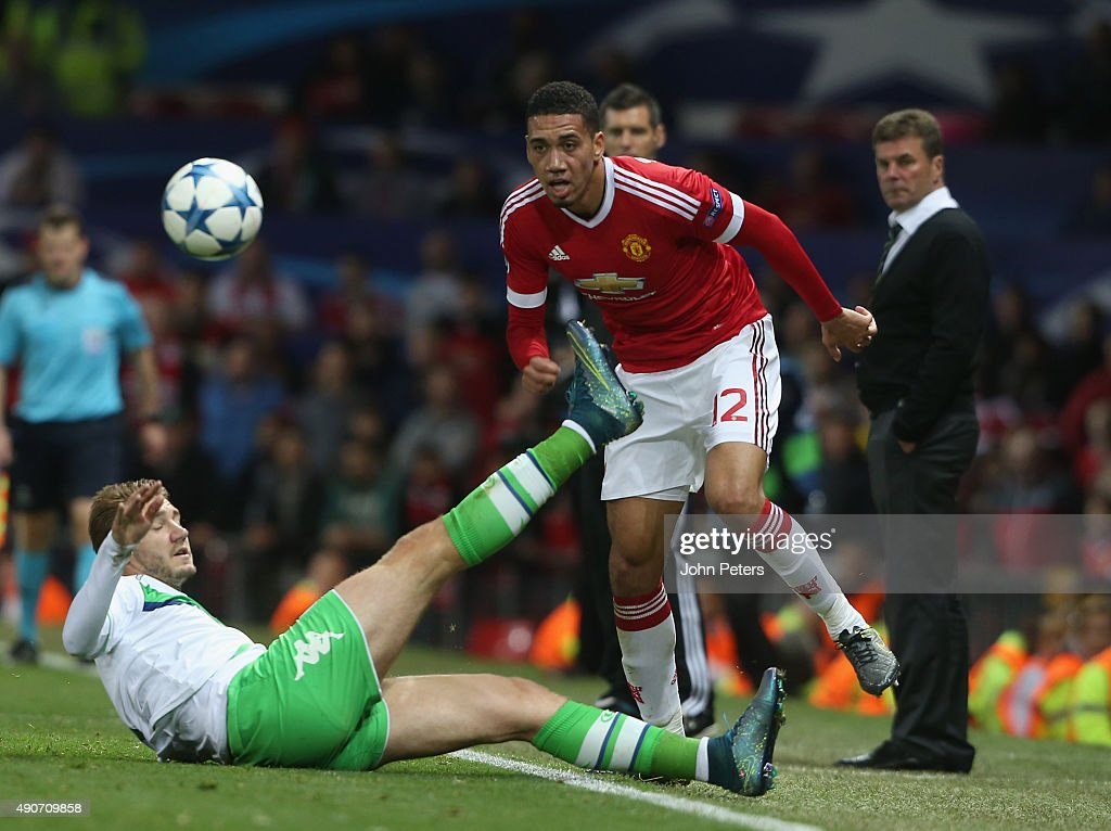 Chris Smalling of Manchester United in action with Nicklas Bendtner of Wolfsburg during the UEFA Champions League Group C match between Manchester United and Wolfsburg at Old Trafford on September 30, 2015 in Manchester, United Kingdom.