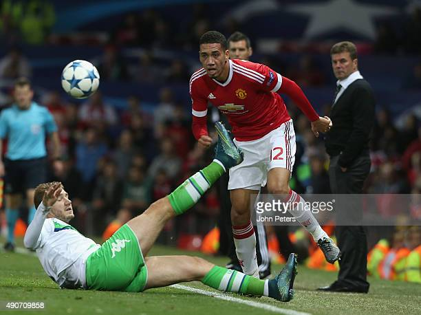 Chris Smalling of Manchester United in action with Nicklas Bendtner of Wolfsburg during the UEFA Champions League Group C match between Manchester...