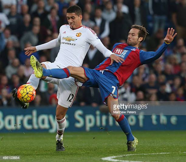 Chris Smalling of Manchester United in action with Yohan Cabaye of Crystal Palace during the Barclays Premier League match between Crystal Palace and...