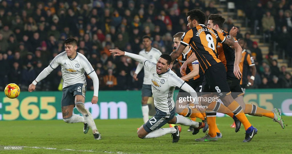 Chris Smalling of Manchester United is brought down by Tom Huddlestone of Hull City but no penalty is given during the EFL Cup Semi-Final second leg match between Hull City and Manchester United at KCOM Stadium on January 26, 2017 in Hull, England.