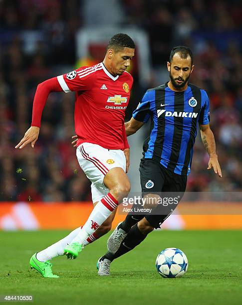 Chris Smalling of Manchester United is closed down by Victor Vazquez of Club Brugge during the UEFA Champions League Qualifying Round Play Off First...