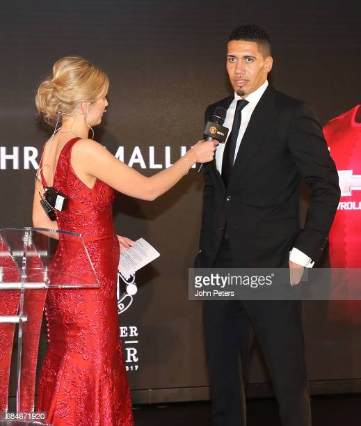 Chris Smalling of Manchester United is interviewed by presenter Rachel Riley at the club's annual Player of the Year awards at Old Trafford on May 18...