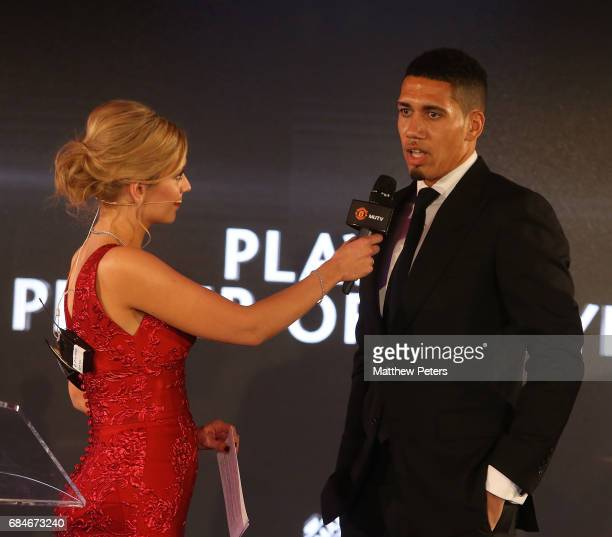 Chris Smalling of Manchester United is interviewed by presenter Rachel Riley at the Manchester United annual Player of the Year awards at Old...