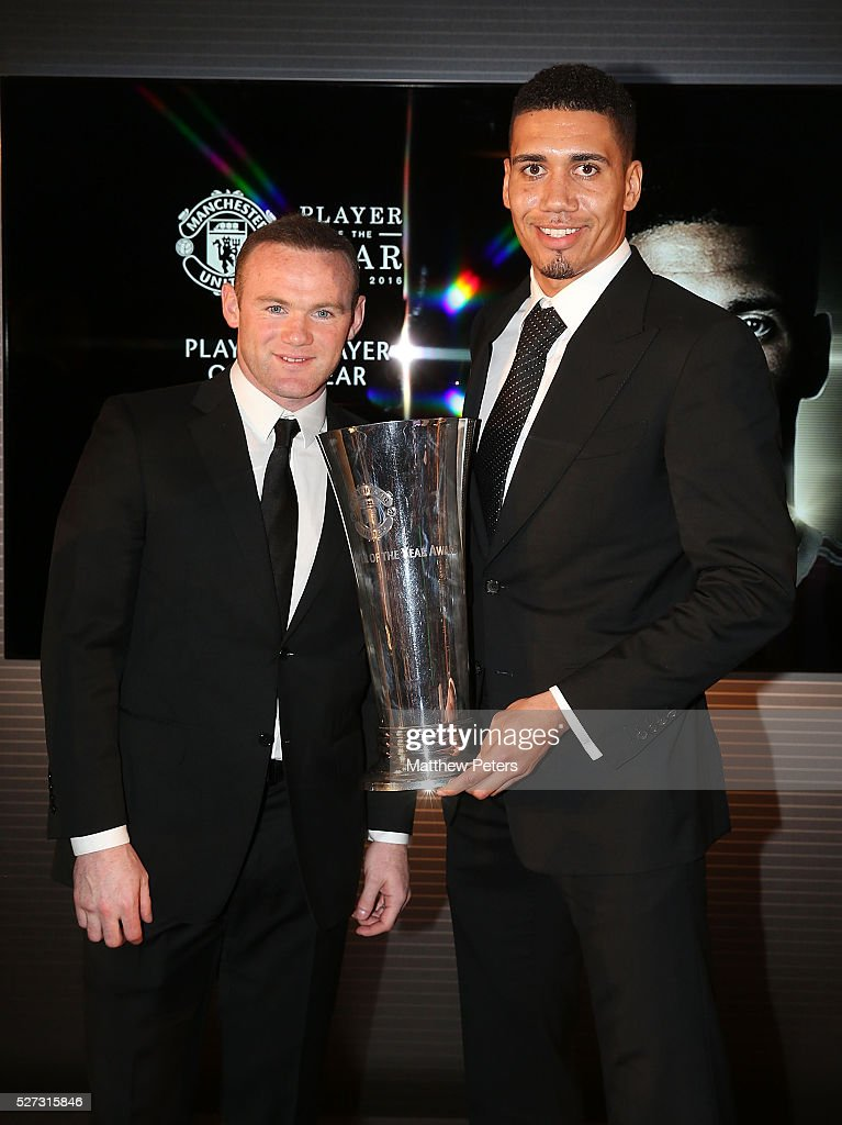 <a gi-track='captionPersonalityLinkClicked' href=/galleries/search?phrase=Chris+Smalling&family=editorial&specificpeople=5964313 ng-click='$event.stopPropagation()'>Chris Smalling</a> of Manchester United is presented with the Players' Player of the Year award by <a gi-track='captionPersonalityLinkClicked' href=/galleries/search?phrase=Wayne+Rooney&family=editorial&specificpeople=157598 ng-click='$event.stopPropagation()'>Wayne Rooney</a> at the club's annual Player of the Year awards at Old Trafford on May 2, 2016 in Manchester, England.