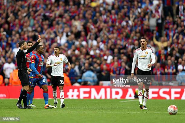 Chris Smalling of Manchester United is sent off by referee Mark Clattenburg after a second booking during The Emirates FA Cup Final match between...