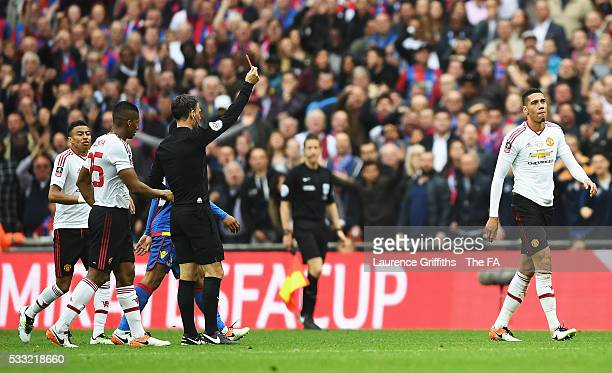 Chris Smalling of Manchester United is shown a red card by Referee Mark Clattenburg during The Emirates FA Cup Final match between Manchester United...