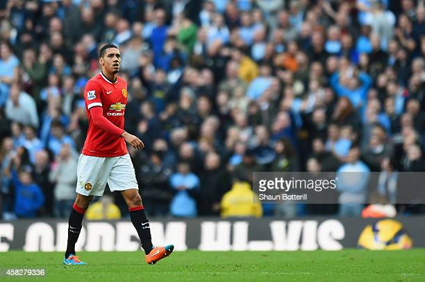 Chris Smalling of Manchester United leaves the field after receiving a red card during the Barclays Premier League match between Manchester City and...