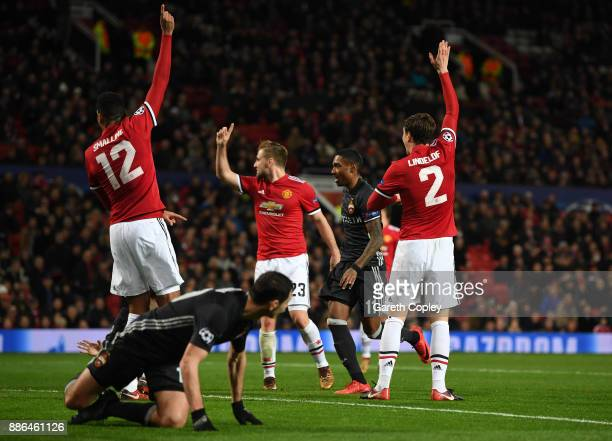 Chris Smalling of Manchester United Luke Shaw of Manchester United and Victor Lindelof of Manchester Unite appeals to the referee during the UEFA...