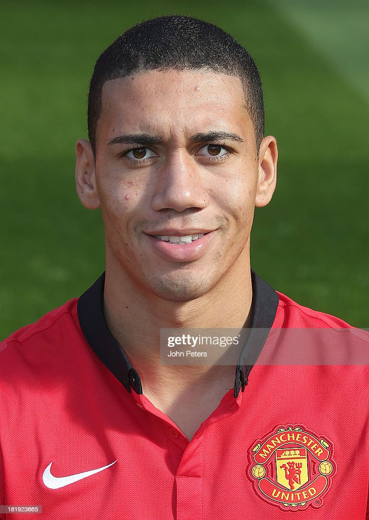 <a gi-track='captionPersonalityLinkClicked' href=/galleries/search?phrase=Chris+Smalling&family=editorial&specificpeople=5964313 ng-click='$event.stopPropagation()'>Chris Smalling</a> of Manchester United poses at the annual club photocall at Old Trafford on September 26, 2013 in Manchester, England.
