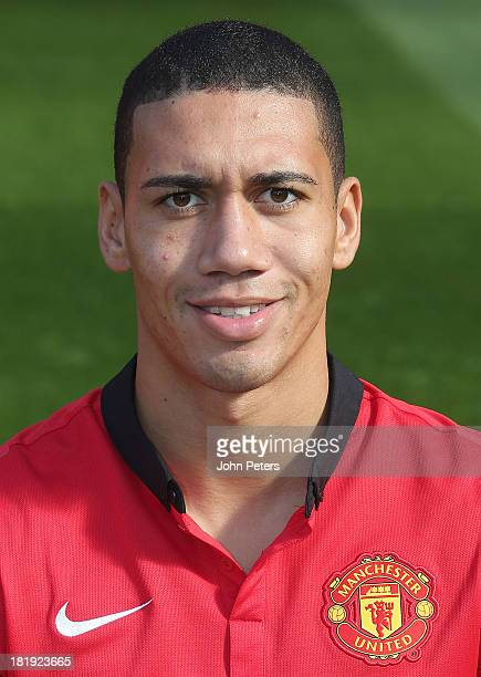 Chris Smalling of Manchester United poses at the annual club photocall at Old Trafford on September 26 2013 in Manchester England