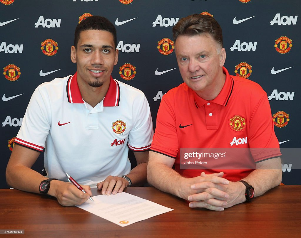 <a gi-track='captionPersonalityLinkClicked' href=/galleries/search?phrase=Chris+Smalling&family=editorial&specificpeople=5964313 ng-click='$event.stopPropagation()'>Chris Smalling</a> of Manchester United (L) poses with manager Louis van Gaal after signing a contract extension at Aon Training Complex on April 21, 2015 in Manchester, England.