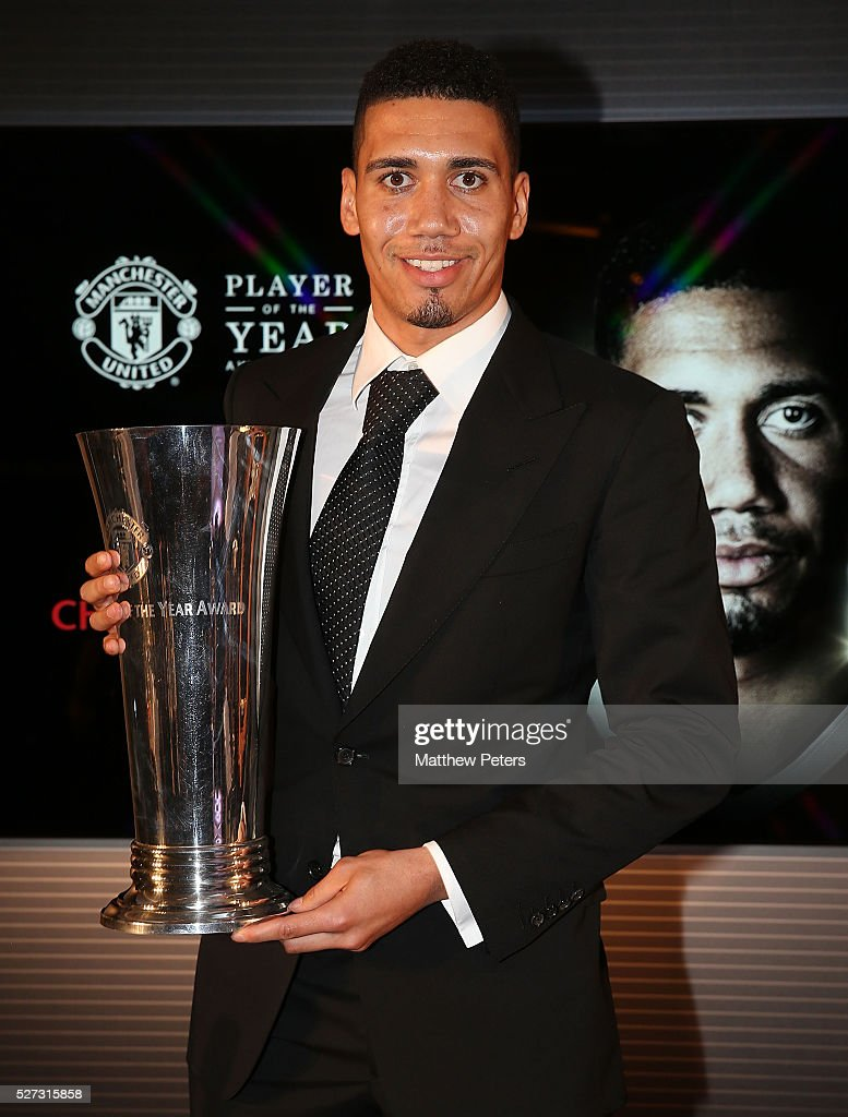 <a gi-track='captionPersonalityLinkClicked' href=/galleries/search?phrase=Chris+Smalling&family=editorial&specificpeople=5964313 ng-click='$event.stopPropagation()'>Chris Smalling</a> of Manchester United poses with the Players' Player of the Year award at the club's annual Player of the Year awards at Old Trafford on May 2, 2016 in Manchester, England.