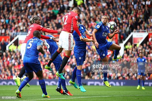 Chris Smalling of Manchester United scores his sides first goal during the Premier League match between Manchester United and Leicester City at Old...