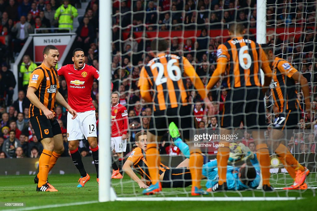 <a gi-track='captionPersonalityLinkClicked' href=/galleries/search?phrase=Chris+Smalling&family=editorial&specificpeople=5964313 ng-click='$event.stopPropagation()'>Chris Smalling</a> of Manchester United scores the opening goal during the Barclays Premier League match between Manchester United and Hull City at Old Trafford on November 29, 2014 in Manchester, England.