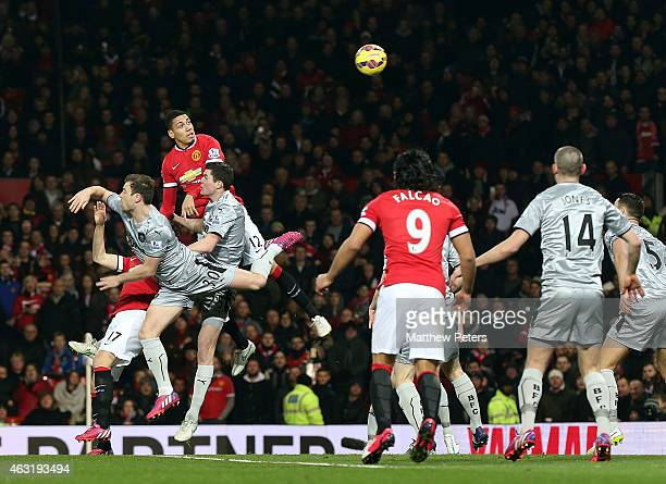 Chris Smalling of Manchester United scores their first goal during the Barclays Premier League match between Manchester United and Burnley at Old...