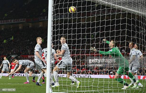 Chris Smalling of Manchester United scores their first goal of Burnley during the Barclays Premier League match between Manchester United and Burnley...